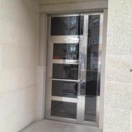 Portal en inox y vidrio